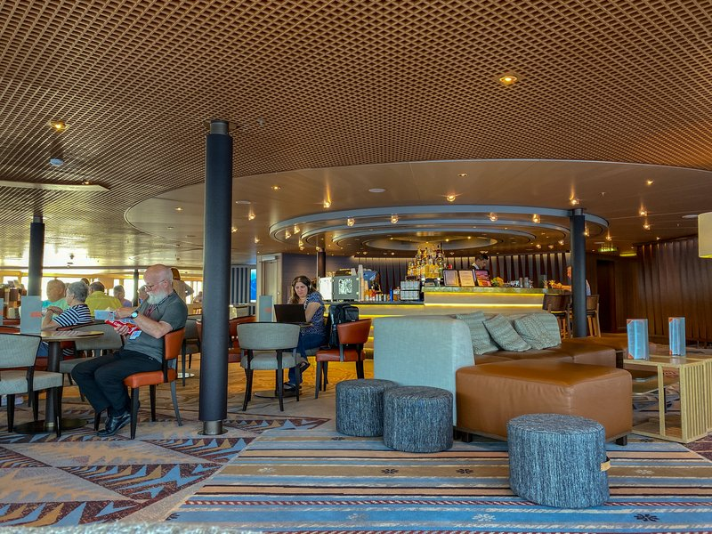 Cruise ship with a bar where passengers can enjoy a cup of coffee with free internet.