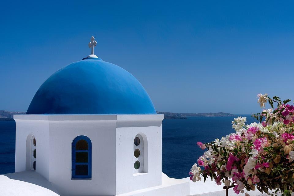 Traditional Greek orthodox blue dome church in Santorini -  3 Day Itinerary in Santorini