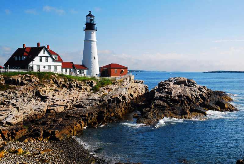 The Portland Head Lighthouse sits along the rocky coast of Maine