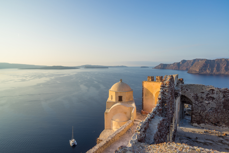 View of Venetian castle in Oia village on Santorini island in Greece